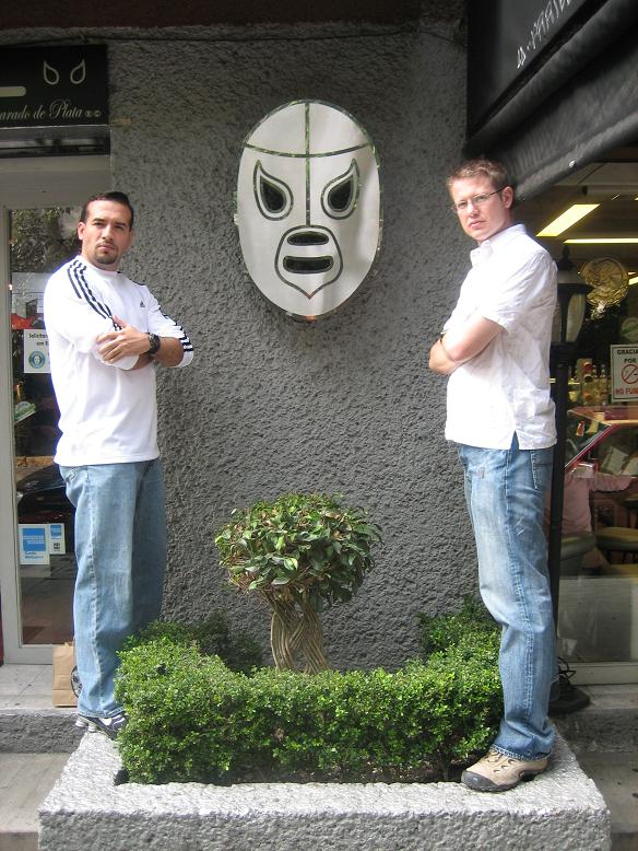 Mark & John take their turns guarding the highly-coveted Santo mask
