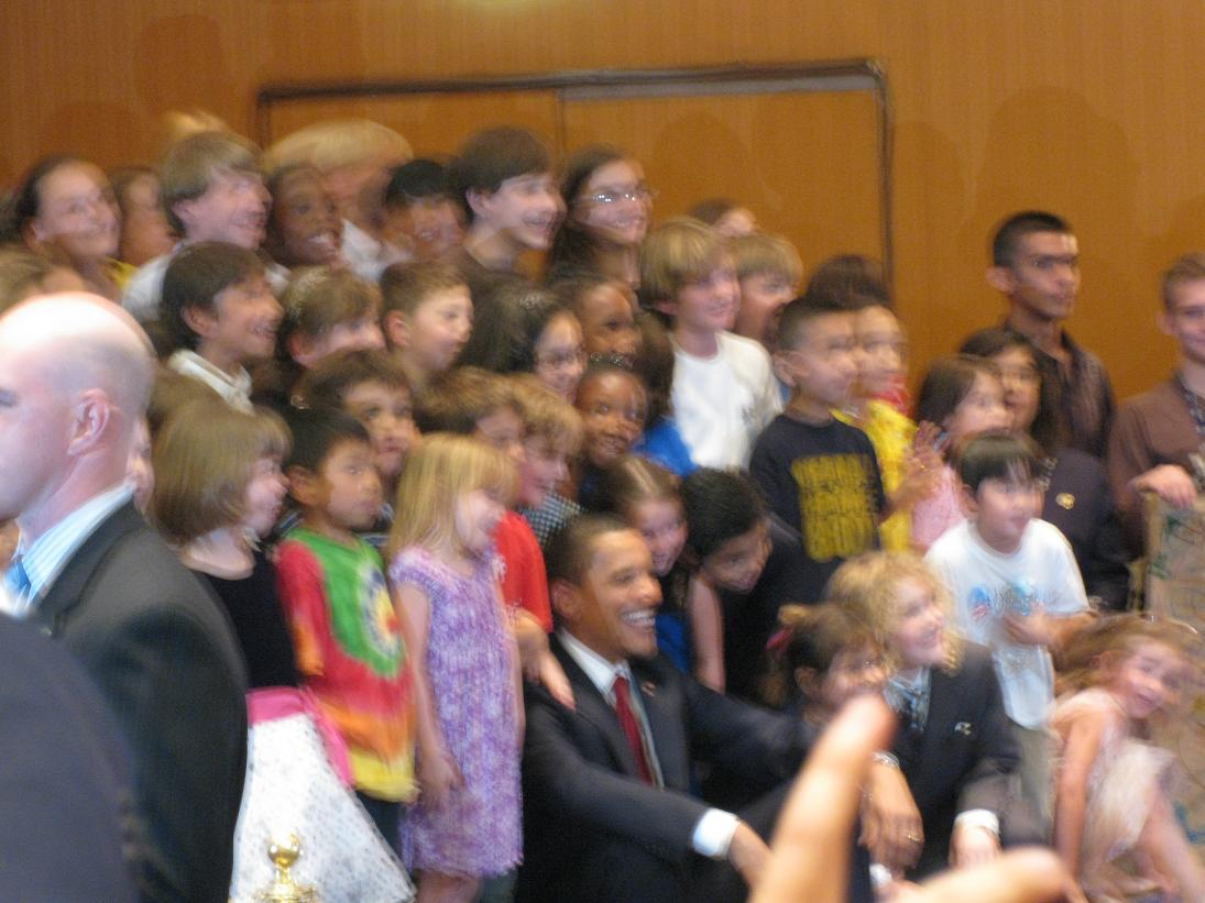 Then he was ushed over to the left for a photo with all the kids over 6 years old, (who a few Embassy employees had managed to keep entertaining/still for at least an hour-- well done). I trust the official photos are less blurry...