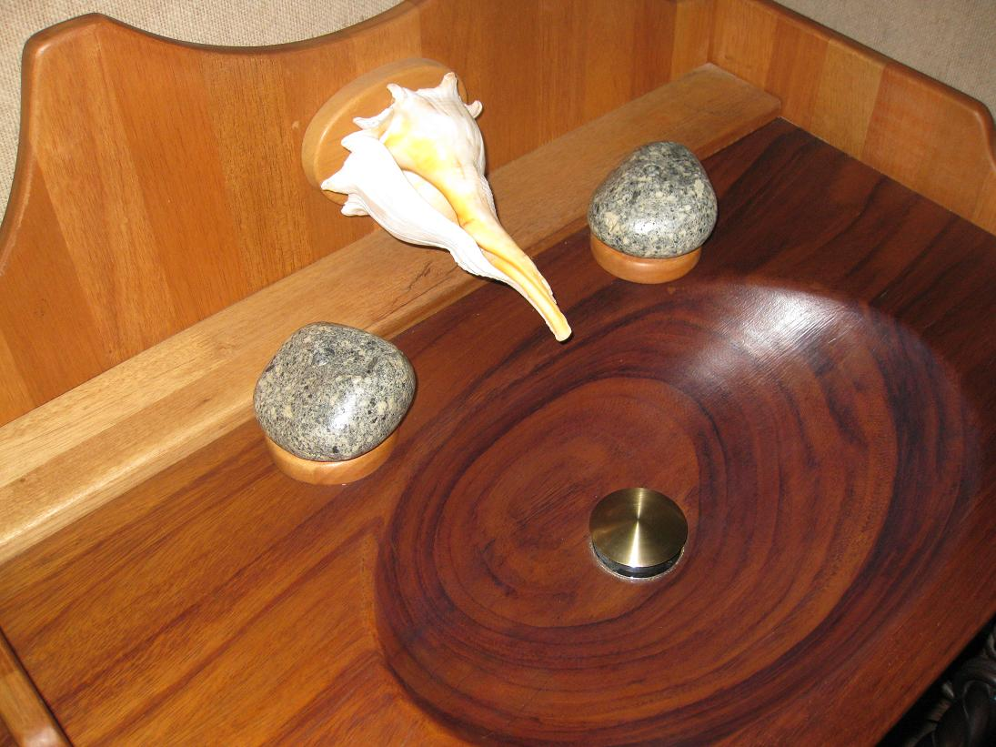 For those of you considering a bathroom remodel, perhaps you have not given fair consideration to a conch shell spout + 2 rock nubbins for handles??