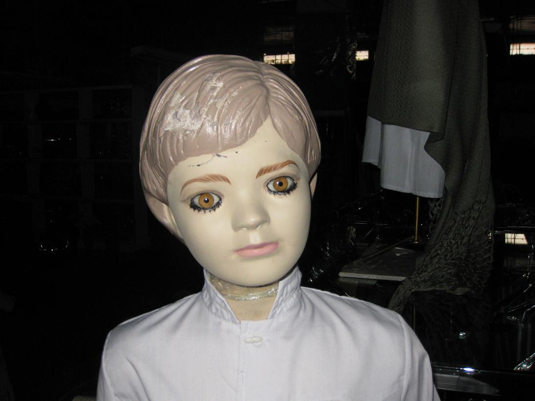 Did someone install this mannequin's eyes upside down? And if this is a boy, should he really be wearing that much eyeliner?