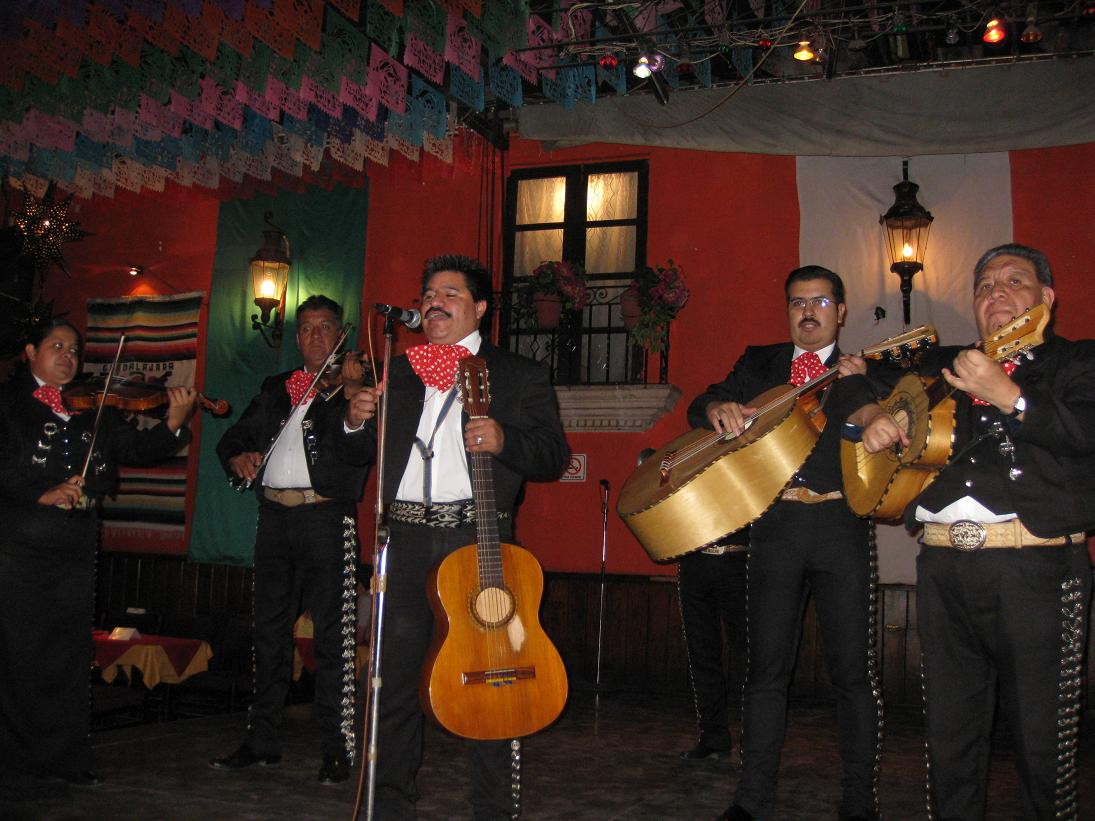 The mariachis make an appearance to get the crowd revved up.