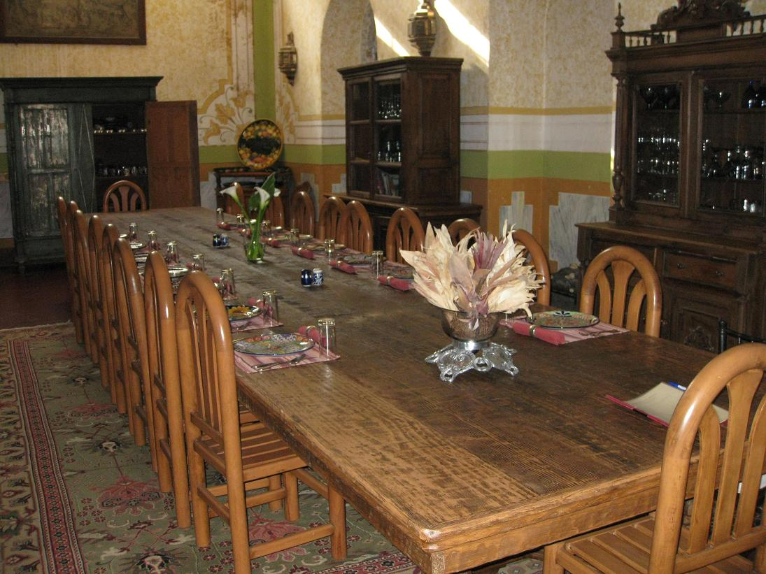 The dining room prepared for our arrival to dinner. Note the cupboards to the right stocked with plenty of wine & margarita glasses.