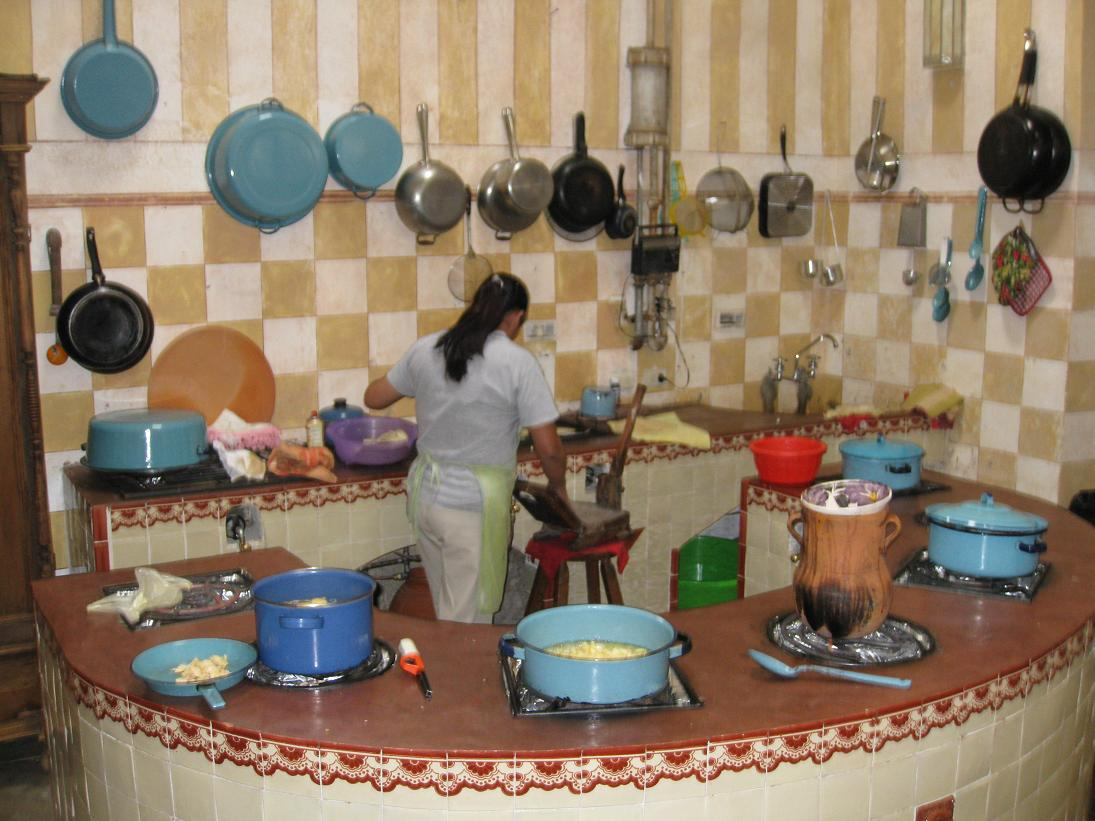Here's where all the good stuff happens-- the kitchen-- under the careful supervision of Yolanda, Amada, Marta, and Concha. Many pots hard at work heating up tasty goodness.