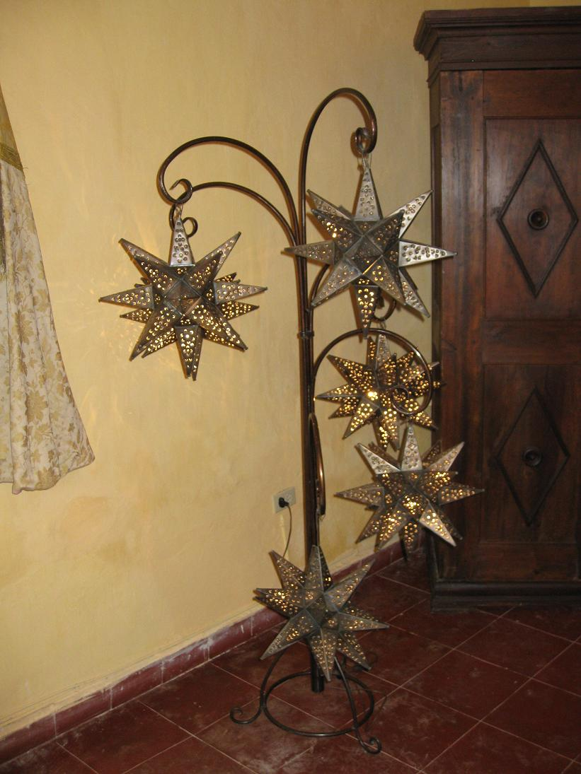This lamp was one of the many pieces of furniture I wanted to steal from Las Trancas. Must find special multi-pronged star light hanger dealie & purchase ASAP.