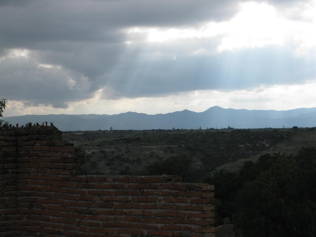 We took a self-guided tour of the hacienda roof, and captured this lovely shot of the sun streaming down with the mountains in the background.