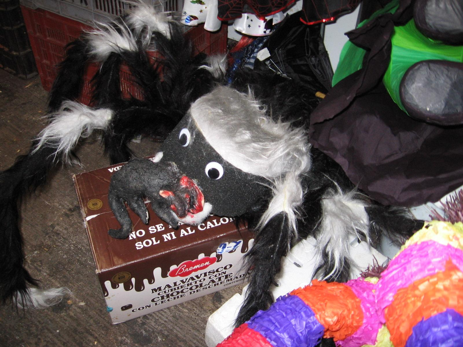 This TOTALLY won't give your kids nightmares-- a wiry/styrofoam spider eating a fake bloody rat. Brilliant!