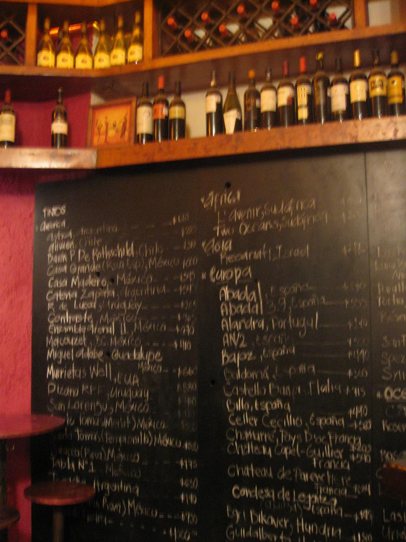 And a blurry view of the wine menu scribbled on the wall...