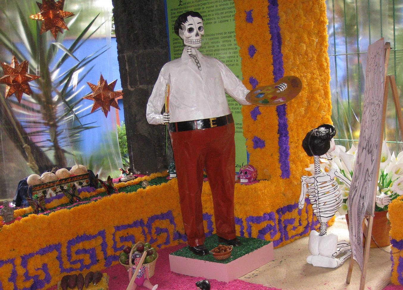 Here's Diego del Muerto at the ofrenda in the garden of the Kahlo museum