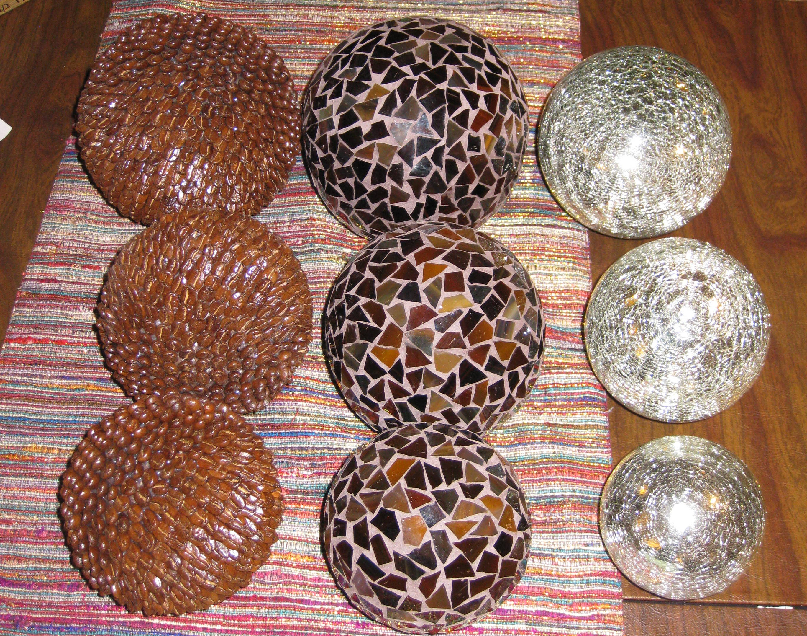 "In keeping with the ""sets of 3"" theme, we also found these decorative balls there... The middle ones have brown shards of glass, the right ones are some wacky crazed silver glass, and the left ones are covered in coffee beans! Don't worry; we don't plan to display them awkwardly in a big clump like this photo depicts."