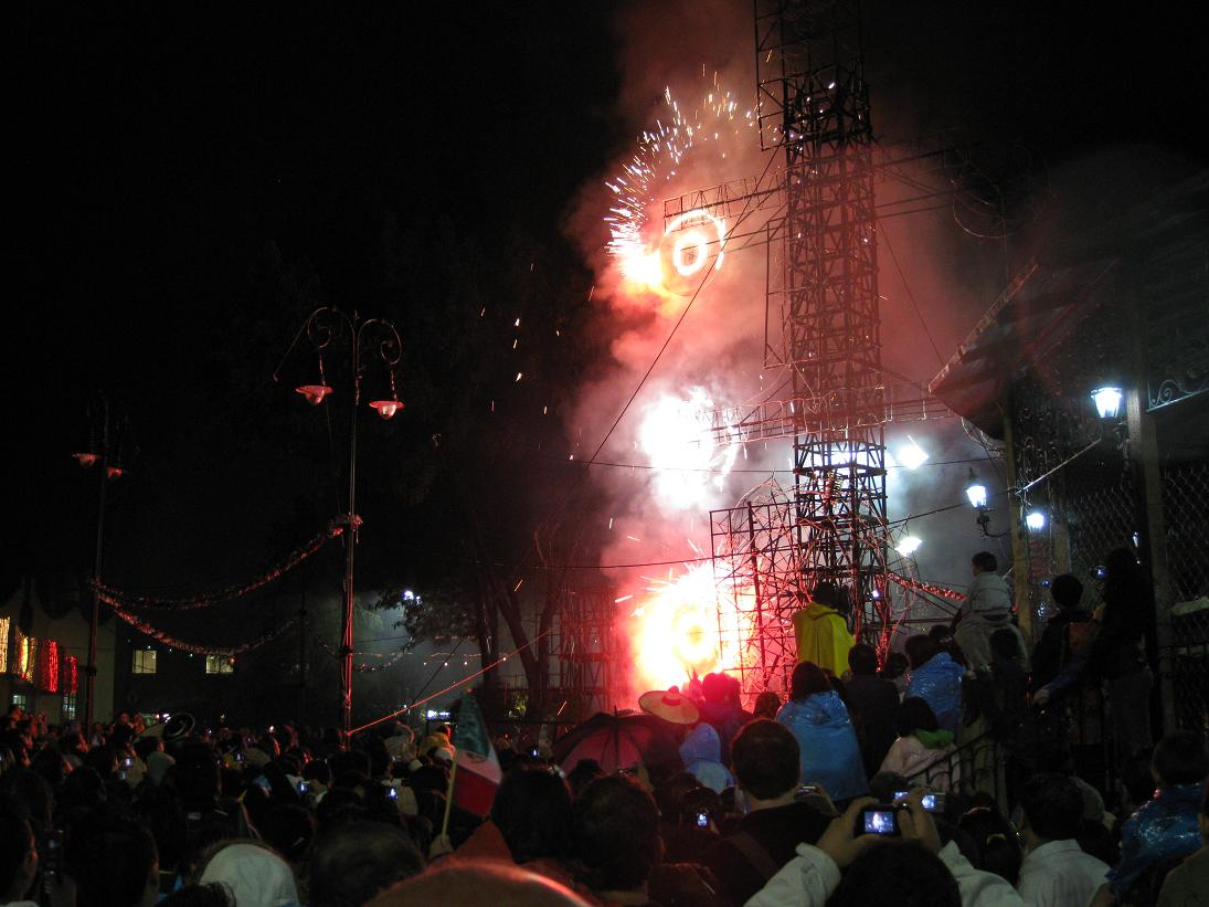 They had an impressive fireworks performance in Coyoacan that included words, dates, and profiles of famous men depicted in flame! Here is a shot of the spinning fireworks, as the crowd (who is tightly pressed around the base of the fireworks) tries to avoid being sprayed by a flurry of sparks.